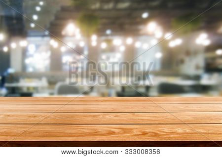 Wood Table In Blur Background Of Modern Restaurant
