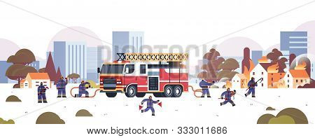 Firemen Near Fire Truck Getting Ready To Extinguishing Fire Firefighters In Uniform And Helmet Firef