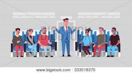 Steward Explaining Instructions For Mix Race Passengers Male Flight Attendant In Uniform Gesturing H
