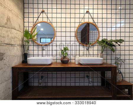 Modern Loft Bathroom Interior Design,white Basin On Wooden Shelf With Tile Wall And A Mirror.