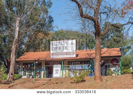 Pilgrims Rest, South Africa - May 21, 2019: A Street Scene, With The Historic Kuzzulos Emporium Buil
