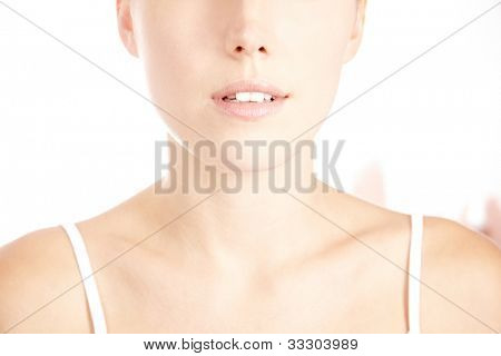 Decollete of young attractive woman with perfect flawless skin