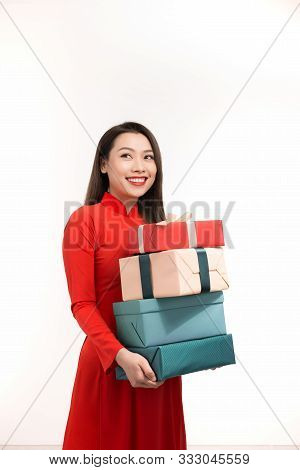 Vietnamese Girl In Ao Dai With Gift Boxes On White Background, Concept New Year Sale