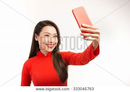 Asian Young Woman In Red Ao Dai Take The Selfie