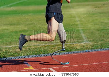 Amputee Athlete Participates In A Race. Man With Prosthetic Leg