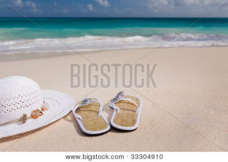 Hat And Flip-flops On The Beach