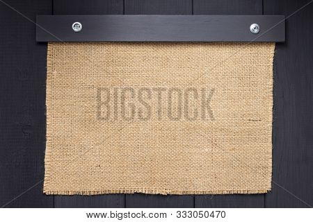 burlap hessian sacking texture on wooden background surface