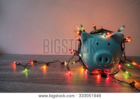 Blue Piggy Bank With Party Light, Planning A Party For The Event Where Successful In Saving Money Fo