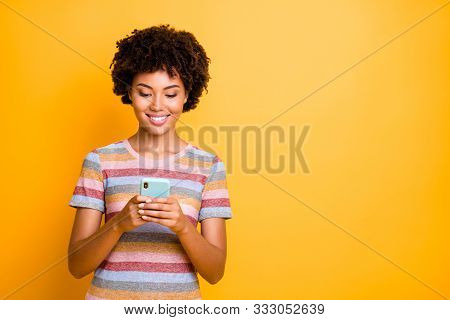 Photo Of Cheerful Cute Charming Positive Girlfriend Browsing Through Her Telephone Searching For New