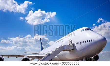 Modern Jumbo Jet Against A Blue Sky