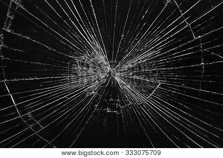 Broken Glass Pane. Dark Smashed Glass Window