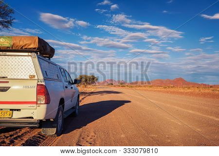 Karas, Namibia - March 30, 2019: Typical 4x4 Rental Car In Namibia Equipped With Camping Gear And A