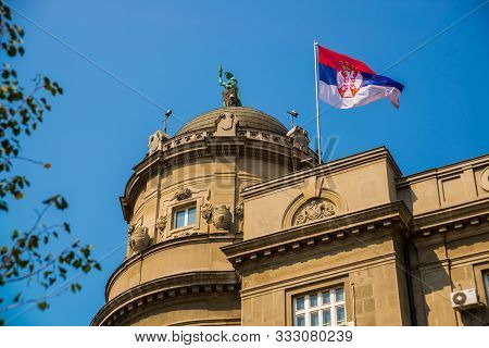 Beograd, Serbia: Flag Of Serbia On The Roof Of The Rear. Beautiful Street With Houses In The Old Tow