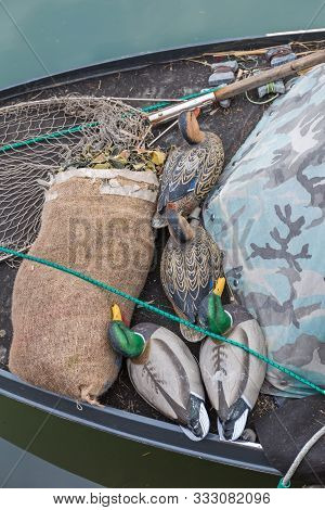 Decoy Ducks Hunting Equipment At Fishing Boat