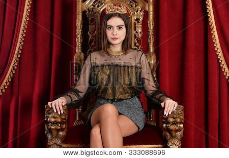 Portrait Of A Cute Queen Sitting On Throne
