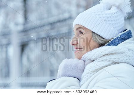 Happy Beautiful Senior Woman In Warm Hat