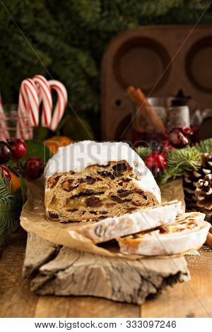 Traditional Christmass Stollen With Marzipan And Dried Fruit On Rustic Background