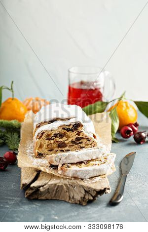 Traditional Christmass Stollen With Marzipan And Dried Fruit On Light Background