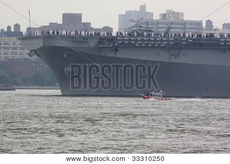 HOBOKEN, NJ  MAY 23: The warship USS Wasp (LHD 1) sails on the Hudson River past Manhattan during the Parade of Sail on May 23, 2012 in Hoboken, NJ. The parade is the start of Fleet Week.
