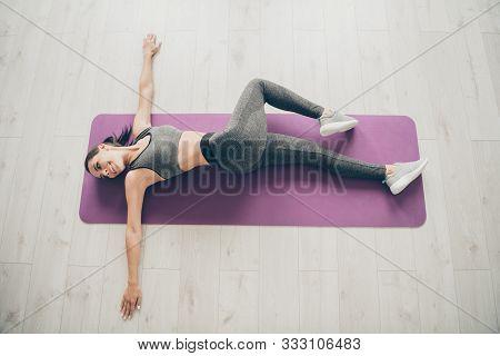 Top Above High Angle Photo Of Sportive Woman Lie On Purple Mat Doing Gymnastics Exercise Follow Regi