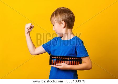 Happy Boy Trains His Brain With Abacus. Mental Arithmetic School. Everyday Workouts Make You Strong.