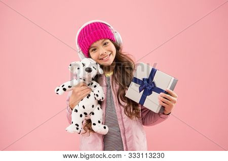 Cute Dog Toy Quickly Became Her Favourite Friend. Happy Child Got Toy Gift Pink Background. Little G