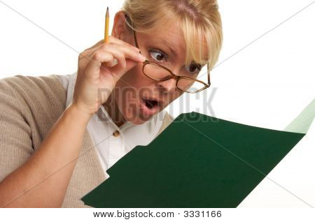 Amazed Woman With Pencil And Folder