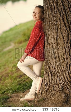 Peaceful Mood. Good Vibes Only. Girl Little Cute Child Enjoy Peace And Tranquility At Tree Trunk. Pl