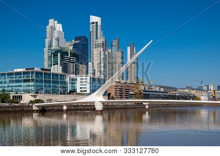 Buenos Aries, Argentina, - April, 20, 2019: The Waterfront (puerto Madero) With The Puente De La Muj