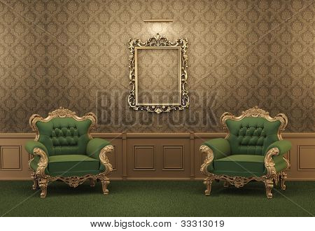 Armchairs And Empty Golden Frame On A Wall. Royal Apartment. Luxurious Interior. Baroque Furniture