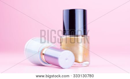 Two Bottle Of Nail Polish On Pink Background