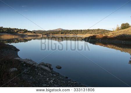Reservoir Of The Swamp Of Pedrezuela In Madrid. Mirror In The Water