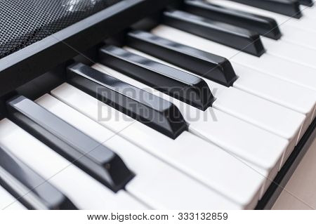 Close-up Photo Of Electronic Musical Midi Piano Keyboard Or Two Octaves Synthesizer And Speaker. Mus