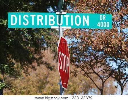 Distribution Drive Street Sign Is In A New Industrial Warehouse Park. The Street  Names Are Key To W