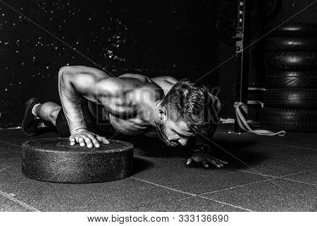 Push Ups Workout, Young Strong Sweaty Focused Fit Muscular Man With Big Muscles Performing Push Ups