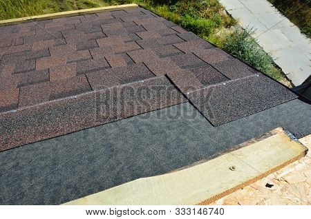 Laying And Installing Asphalt Shingles. House Roof Asphalt Shingles Repair. Roofing Construction Wit