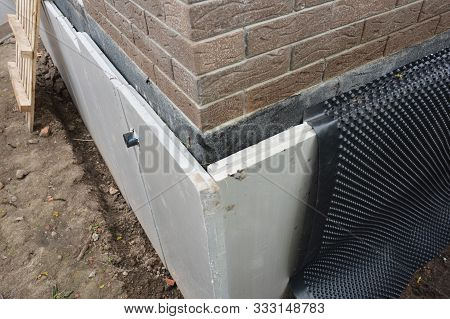 Foundation Insulation And Damp Proofing In Problem Corner Area. House Basement,foundation Insulation