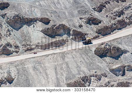Chuquicamata, Chile - January 14: Big trucks and machinery at Chuquicamata, world's biggest open pit copper mine, Calama, Chile. Mining Operations at open pit Copper Mine near Calama, Northern Chile.