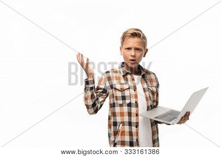 Discouraged Boy Holding Laptop, Looking At Camera And Showing Shrug Gesture Isolated On White