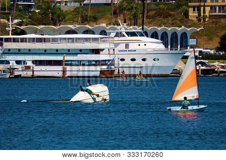 August 25, 2019 In Newport Beach Harbor, Ca  People Sailing And Capsizing On Dinghy Sail Boats In Th