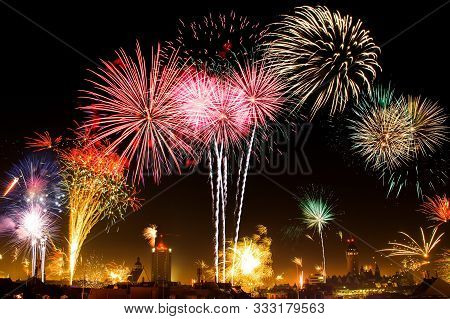 4k. Loop Seamless Of Real Fireworks Background. Abstract Blur Of Real Golden Shining Fireworks With