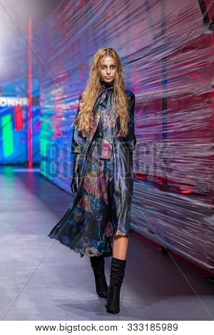 ZAGREB, CROATIA - OCTOBER 26, 2019: Fashion model wears clothes designed by the Croatian designer duo 'Twins' at the 'Fashion.hr' fashion show