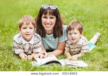 Mother And Sons Reading Book Outdoor