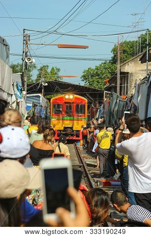 2019 July 15. Samut Songkhram Thailand. Clowd Of People Taking A Photo Of A Train While Passing Tala