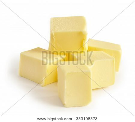 Pieces Of Butter Isolated On White Background, Selective Focus