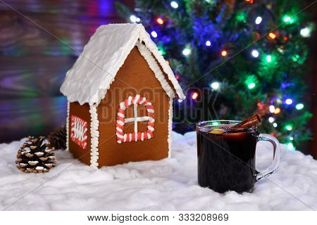 The Hand-made Eatable Gingerbread House, Snow Decoration, Hot Wine And New Year Tree With Garland In