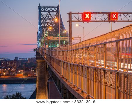 Long Exposure Shot Of Jacques Cartier Bridge Illumination In Montreal, Quebec, Canada.