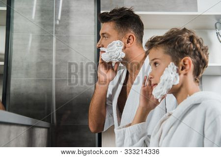Selective Focus Of Father Applying Shaving Foam On Face Near Son In Bathroom