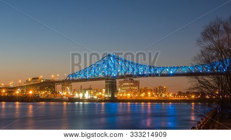 Long Exposure - Spectacular Night View Over The Montreal Jacques Cartier Bridge Illuminated With A S