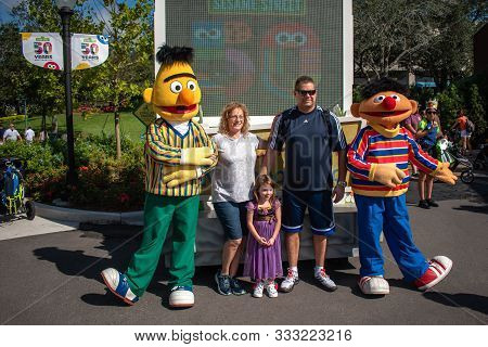 Orlando, Florida. November 09, 2019. Family Taking Picture With Ernie And Bert In Sesame Street At S